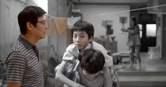 young jae yul sees his mother in the reflection of a wall mirror.